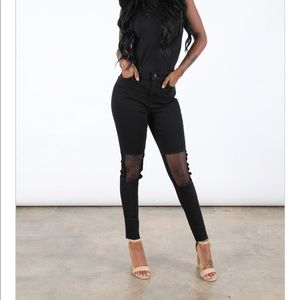 Black skinny high waisted jeans with mesh knees